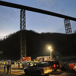 FILE - In an April 5, 2010 file photo, West Virginia State Police direct traffic at the entrance to Massey Energy's Upper Big Branch Coal Mine in Montcoal, W.Va.   An explosion fueled by methane and coal dust ripped through the seven miles of underground corridors at the mine on April 5, 2010 killing 29 men.
