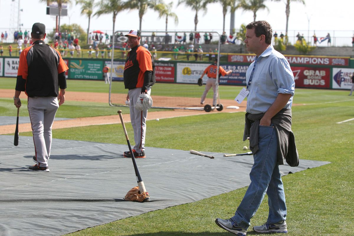 ...and for no reason, here's a picture of Buster Olney walking the lines at Ed Smith.
