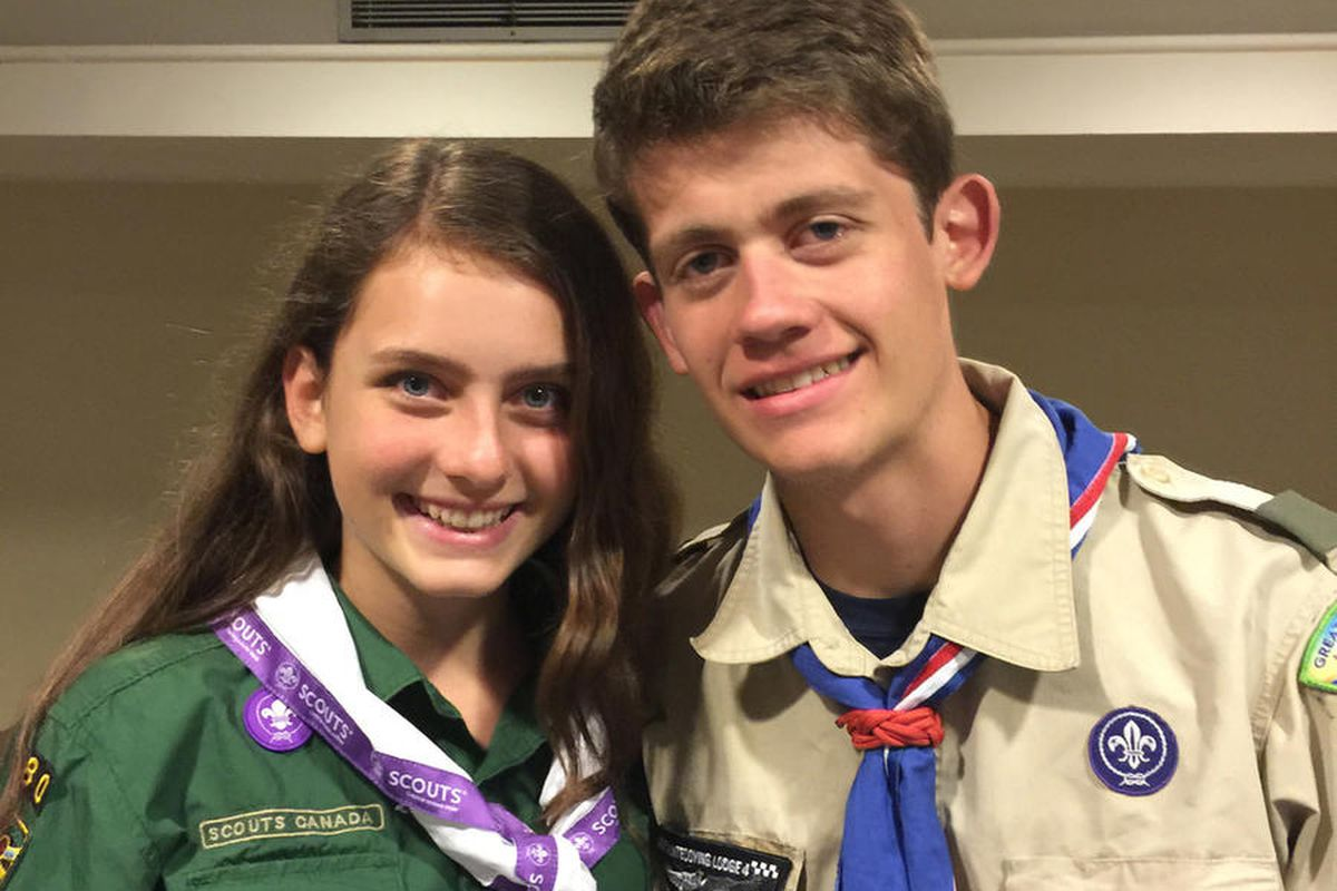 This June 2016 provided by their father, Gary Ireland, shows 15-year-old Sydney Ireland, left, of New York, with her bother, Bryan, who is an Eagle Scout, at a National Organization for Women conference in Washington. For several years, Sydney has been an