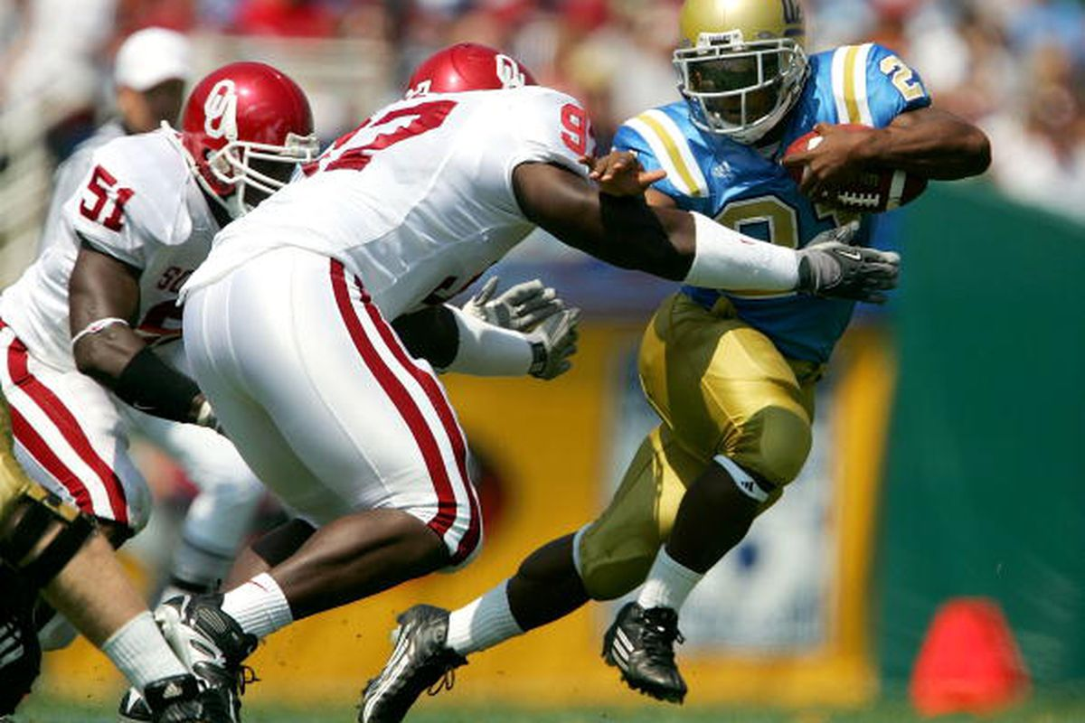 MJD moves away from a tackle by the Sooner's Cory Bennett (#97). Bruins beat Oklahoma 41-24 at the Rose Bowl on September 17, 2005.  (Photo by Jeff Gross/Getty Images)