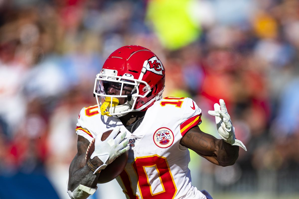 Tyreek Hill of the Kansas City Chiefs runs with the ball during the second quarter against the Tennessee Titans at Nissan Stadium on November 10, 2019 in Nashville, Tennessee.