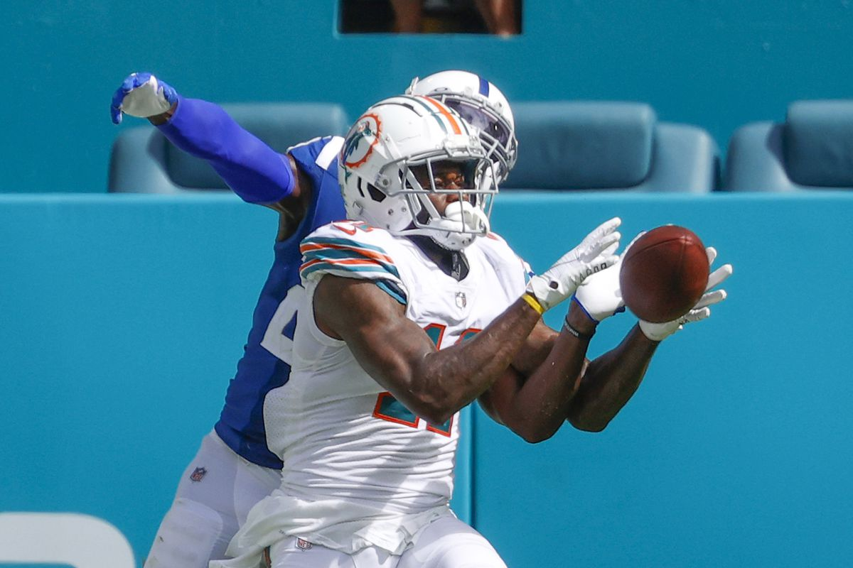 DeVante Parker #11 of the Miami Dolphins catches the ball against the Indianapolis Colts during an NFL game on October 3, 2021 at Hard Rock Stadium in Miami Gardens, Florida.