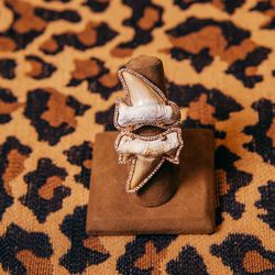 "<b>Borgioni</b> double shark tooth ring, <a href=""http://www.fragments.com/double-shark-tooth-ring.html?___store=default"">$5,630</a>."