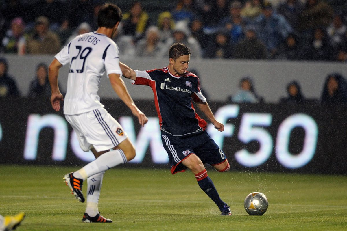 Mar 31, 2012; Carson, CA, USA; New England Revolution defenseman Chris Tierney (8) attempts a shot defended by Los Angeles Galaxy defenseman Andrew Boyens (29) during the first half at the Home Depot Center. Mandatory Credit: Kelvin Kuo-US PRESSWIRE