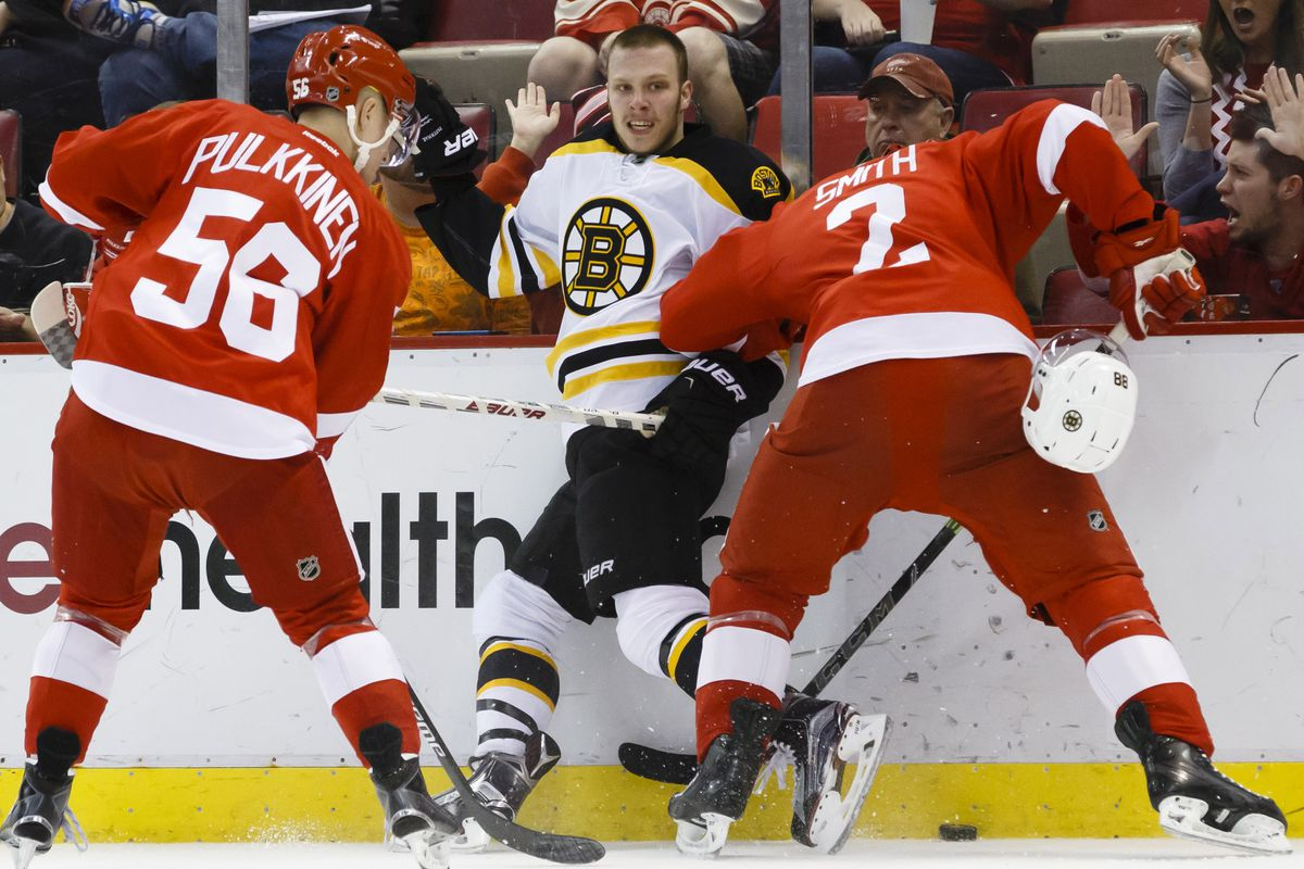 David Pastrnak mixes it up with Reilly Smith's brother along the boards