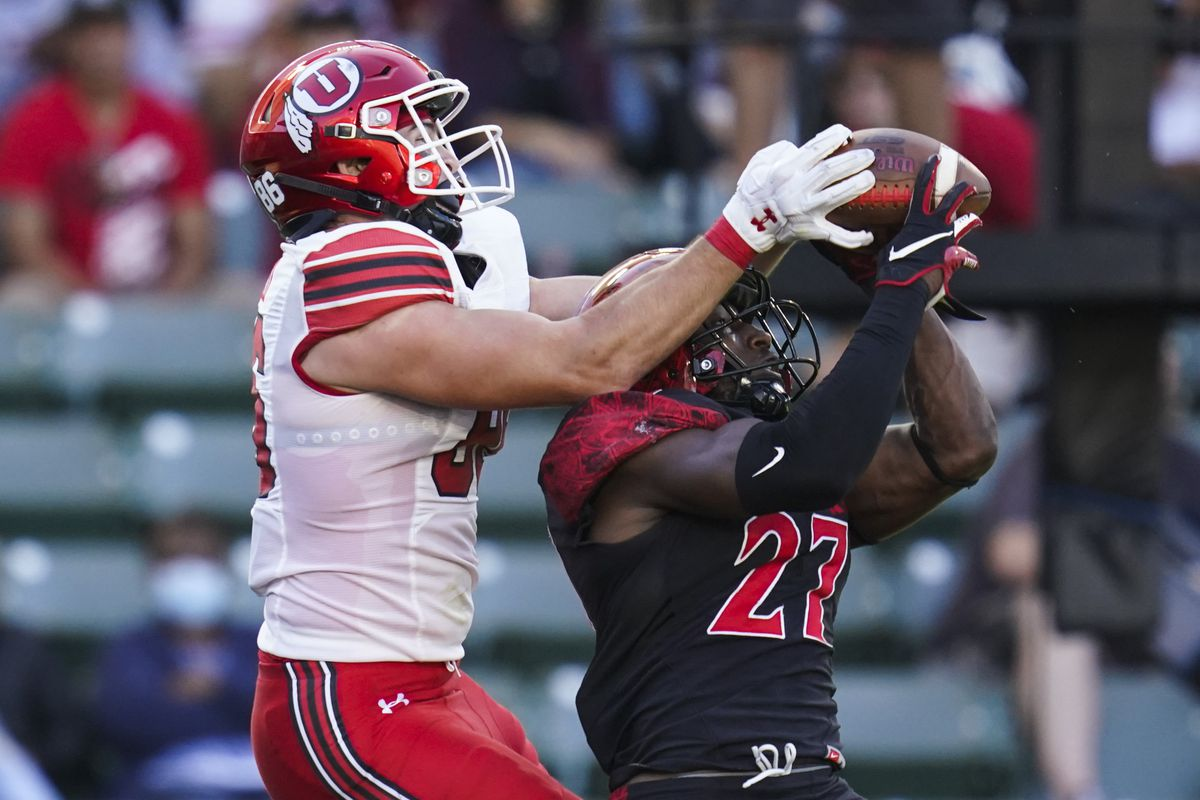 Utah tight end Dalton Kincaid  and San Diego State safety Cedarious Barfield try to catch a pass intended for Kincaid in the end zone.