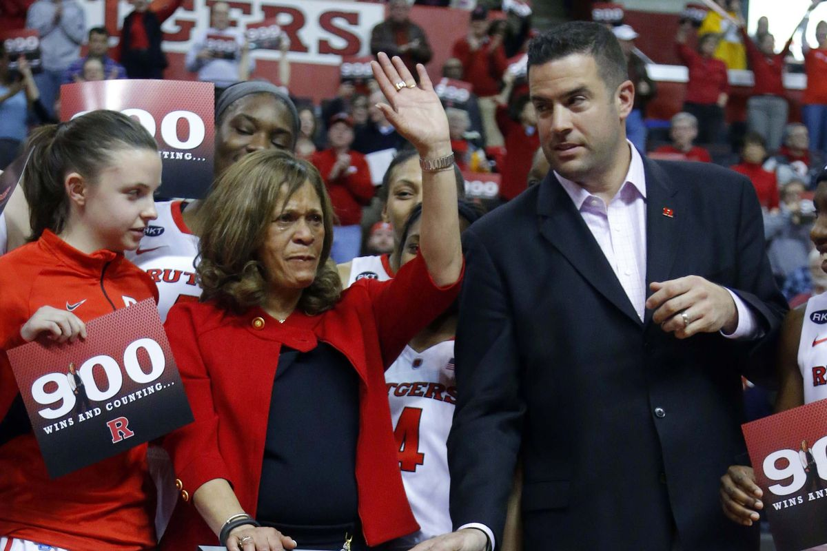 Rutgers Scarlet Knights athletic director Tim Pernetti presents head coach C. Vivian Stringer with framed jersey in honor of her 900th career coaching victory after her win against the South Florida Bulls.