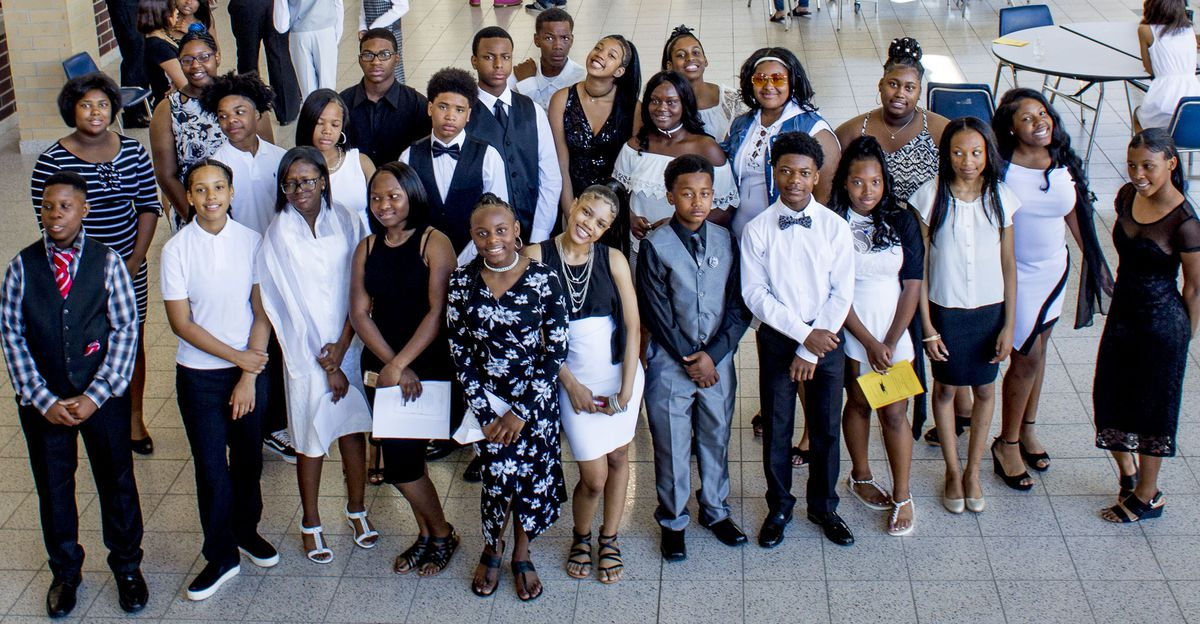 The students of homeroom 8B at Bethune Elementary-Middle School at their eighth-grade graduation ceremony. Eleven of 31 students didn't enroll in the school until eighth grade.