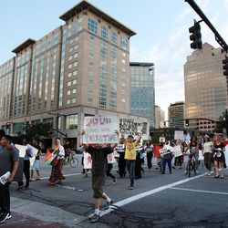 Demonstrators march during a pro-Palestine rally in Salt Lake City, Thursday, July 31, 2014.