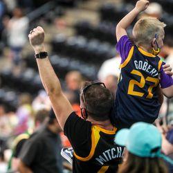 Utah Jazz fans cheer as the Utah Jazz and the Toronto Raptors play an NBA basketball game at Vivint Smart Home Arena in Salt Lake City on Saturday, May 1, 2021.
