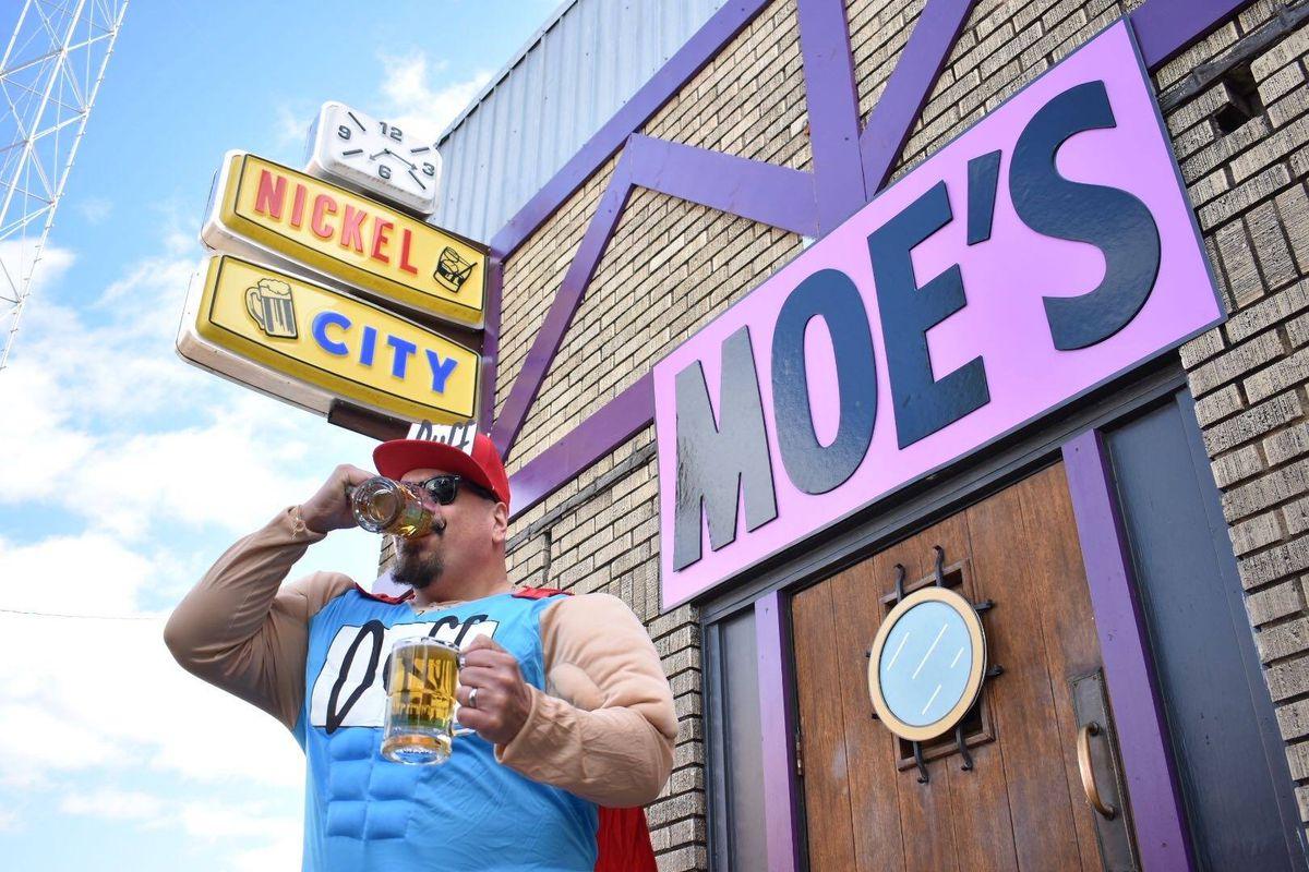 Duffman in front of Nickel City as Moe's Tavern