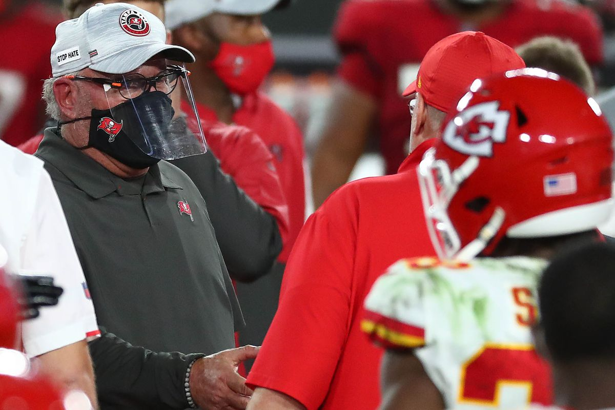 Tampa Bay Buccaneers head coach Bruce Arians meets with Kansas City Chiefs head coach Andy Reid following the loss at Raymond James Stadium.