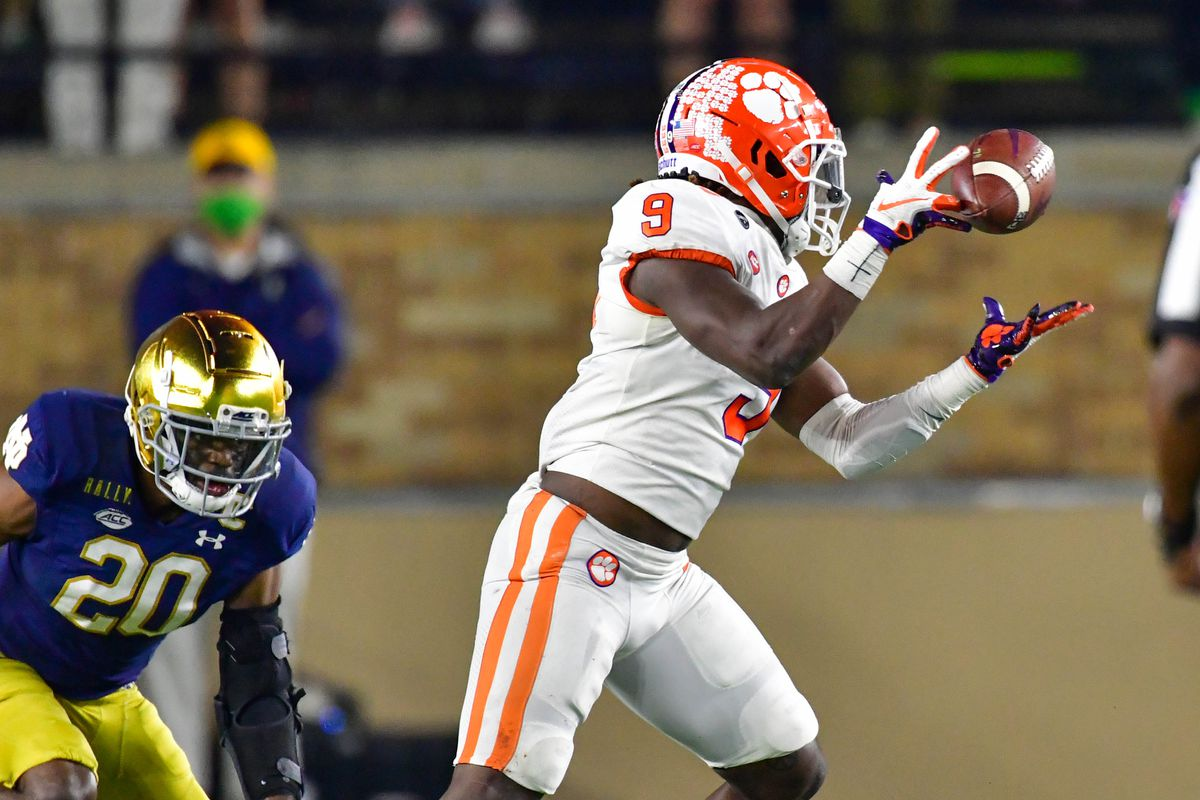 Running back Travis Etienne of the Clemson Tigers drops a pass as safety Shaun Crawford of the Notre Dame Fighting Irish defends in the second quarter at Notre Dame Stadium on November 7, 2020 in South Bend, Indiana.