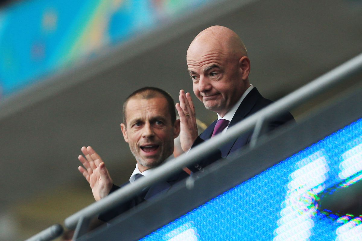 UEFA President Aleksander Ceferin (L) talks to FIFA President Gianni Infantino during the UEFA Euro 2020 Championship Final between Italy and England at Wembley Stadium on July 11, 2021