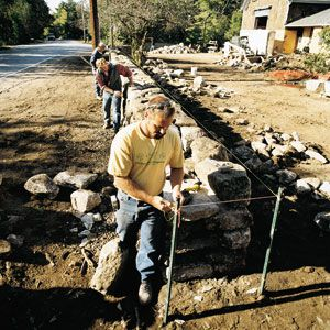 Dry-laid fieldstone is historically accurate for an 1849 farmhouse.