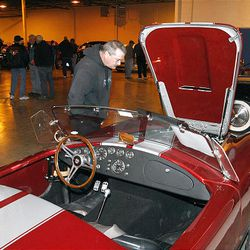 Les Hayden inspects a Shelby Cobra at the U.S. marshals auction Thursday. The marshals held an auction to sell off the $6 million worth of cars, boats and motorcycles of Jeffery Mowen, who is accused of operating a Ponzi scheme.