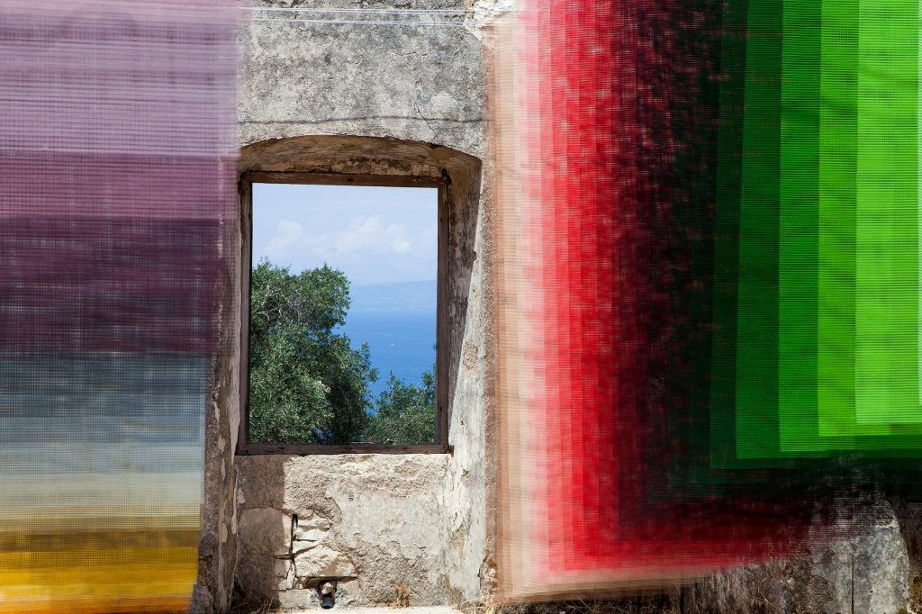 Old ruins with colorful fabric strung up