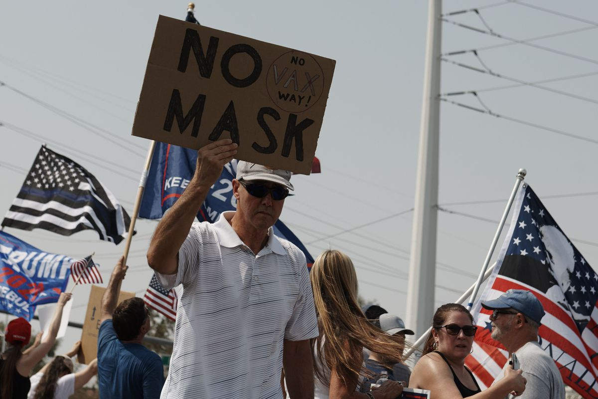 Protesters rally against a mask mandate, many showing support for President Donald Trump, in Las Vegas, Nevada, on Saturday.