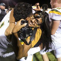 Kearns running back Xavier Afatasi (1) hugs his girlfriend Carla Vazaqueze following a high school football game at Olympus High School in Holladay on Friday, Aug. 30, 2019. Kearns defeated Olympus 26-21.