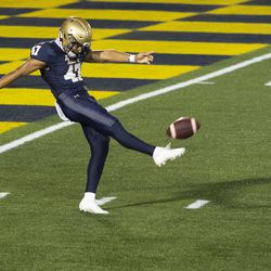 Navy kicker Daniel Davies (47) punts during the second half of an NCAA college football game against BYU, Monday, Sept. 7, 2020, in Annapolis, Md.