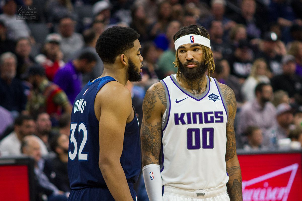 Willie Cauley-Stein of the Sacramento Kings looks at his former Kentucky teammate, Karl-Anthony Towns.