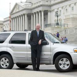 US Senator Bob Bennett stands next to his Ford Escape Hybrid, Thursday May 18, 2006 near the Capitol Building in Washington DC.  (Matt Houston, for the Deseret Morning News)