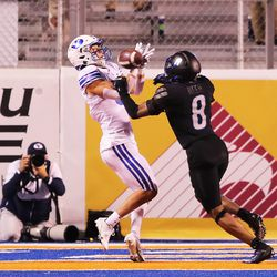 BYU wide receiver Dax Milne (5) is interfered with by Boise State cornerback Markel Reed (8) in the end zone as BYU and Boise State play a college football game at Albertsons Stadium in Boise on Friday, Nov. 6, 2020.