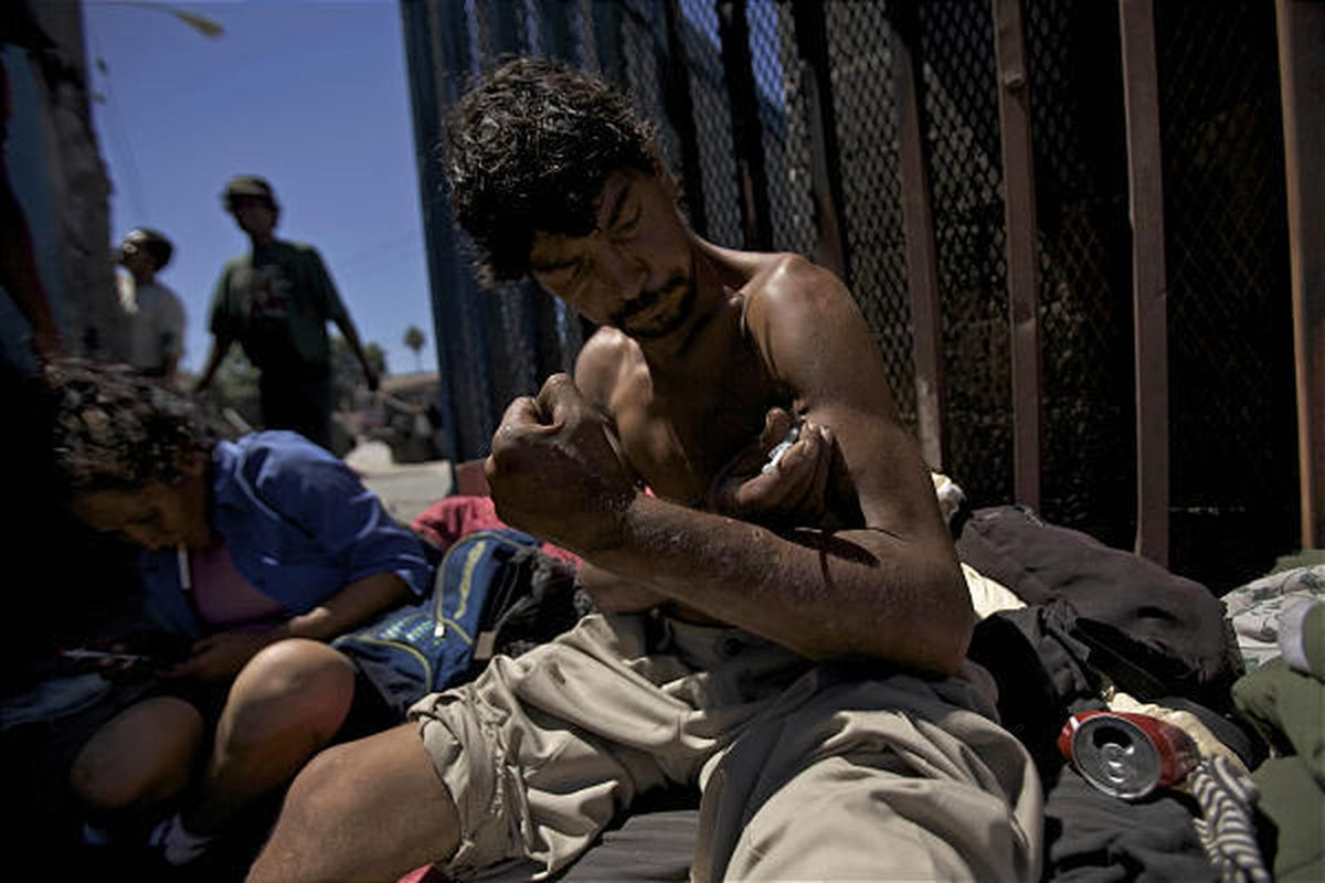 Victor Moreno, 40, a drug addict with a 20-year-old habit, shoots up near the border in Tijuana, Mexico, Tuesday.