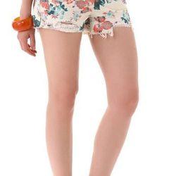 """<a href=""""http://www.shopbop.com/printed-denim-floral-cut-off/vp/v=1/845524441941541.htm?folderID=2534374302029428&fm=whatsnew-shopbysize&colorId=30394"""">Free People floral cutoff shorts</a>, $68"""