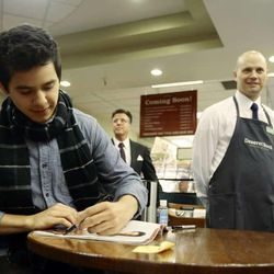 David Archuleta signs a magazine for Lauren Wilcox during a book signing event at the Deseret Book at Ft. Union in Midvale on Nov. 22.