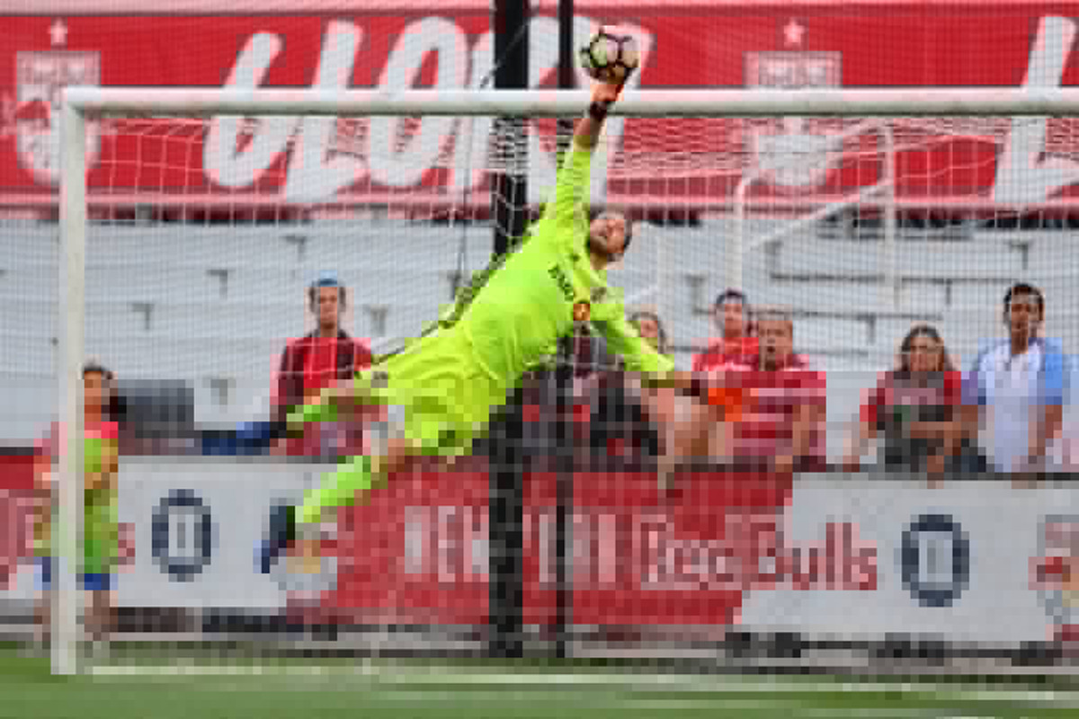 USL Photo - Pais stretches to push a Red Bulls' shot over the bar