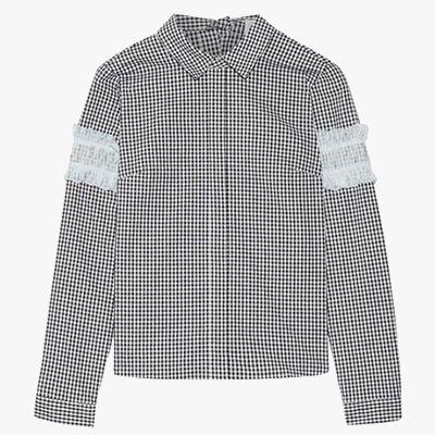 Gingham long sleeved top.