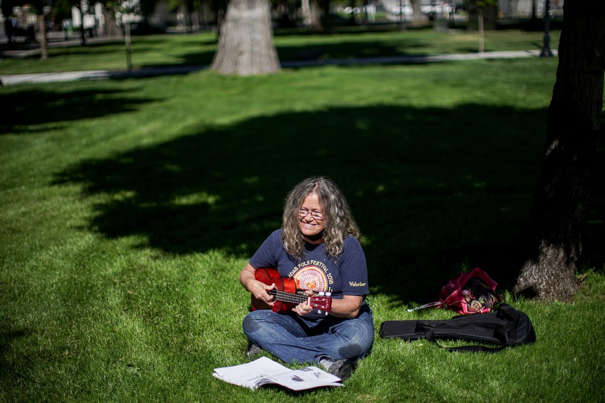 LuAnn Miller poses for a photo with her ukulele at Pioneer Park in Salt Lake City on Wednesday, May 27, 2020. Miller was staying in a homeless resource center when she fell ill with an unknown sickness and was moved to a Salt Lake County isolation center set up to stem the spread of COVID-19. While recovering there shewas given the ukulele as a donation from Summerhays Music.