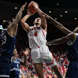 Arizona's Chase Jeter fights to lay in the ball during the Arizona-Georgia Southern game in McKale Center on November 29 in Tucson, Ariz.