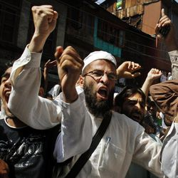 """Kashmiri Muslims shout slogans during a protest against an anti-Islam film called """"Innocence of Muslims"""" that ridicules Islam's Prophet Muhammad, in Srinagar, India, Friday, Sept. 14, 2012."""