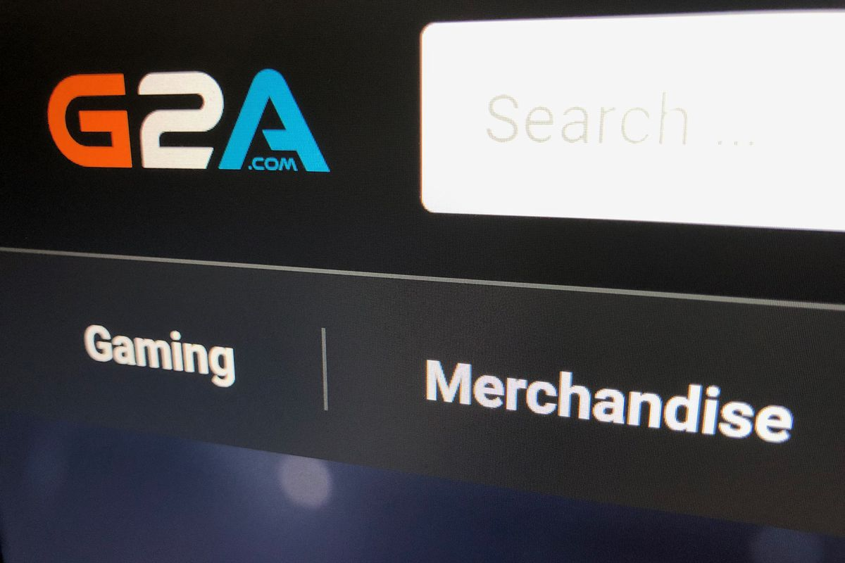 A photograph showing the G2A logo at the top of the G2A Marketplace storefront. Tabs below show gaming and merchandise up for sale.