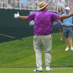 Chris Berman reacts to his perfect drive on the first hole.