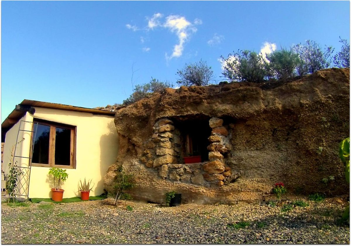 The exterior of a cave house on Tenerife. The facade is dirt and stone.