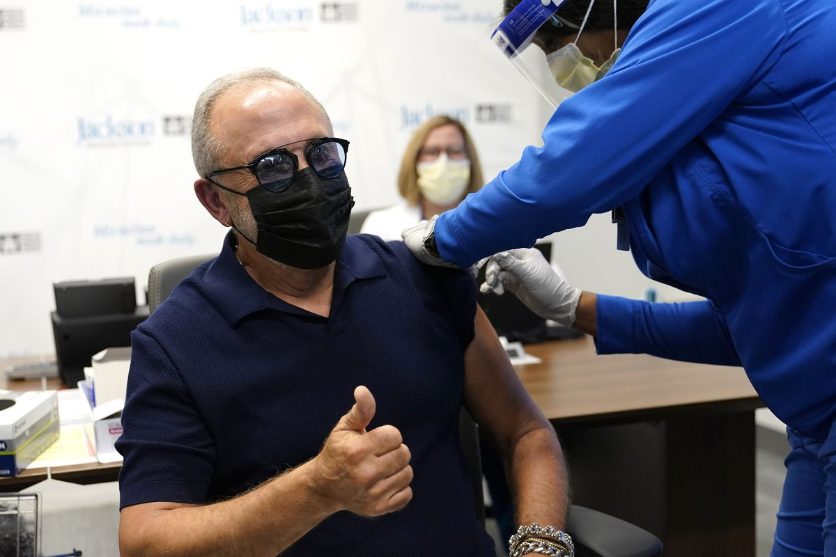 Music producer Emilio Estefan, 67, gives the thumbs-up while he receives the Pfizer-BioNTech COVID-19 vaccine at Jackson Memorial Hospital, Wednesday, Dec. 30, 2020, in Miami.
