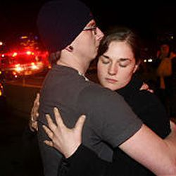 Cassidy Rapier comforts his girlfriend, Marie Smith, after a gunman opened fire at Trolley Square Monday night. Smith watched as the gunman shot a woman in the head outside Bath and Body Works where Smith works. Smith said she ran and hid inside the bathroom to escape the mayhem.