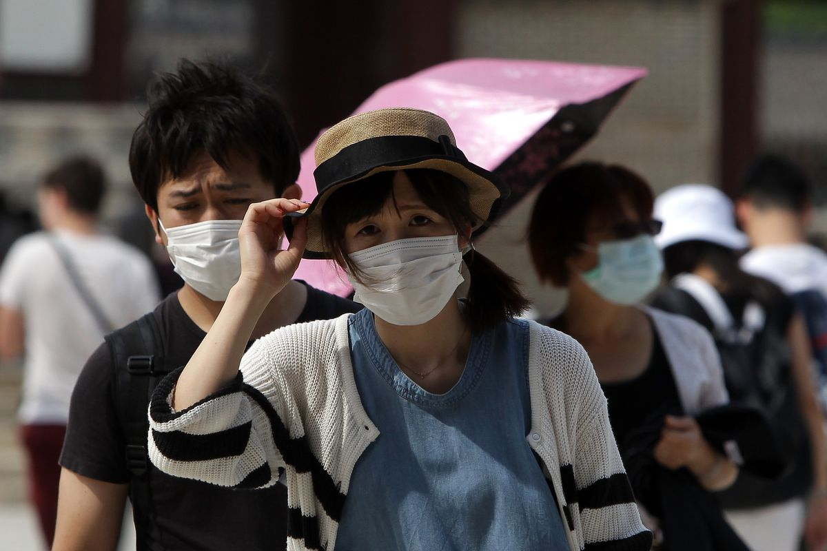Tourists wear masks as a precaution against the MERS virus in Seoul, South Korea.