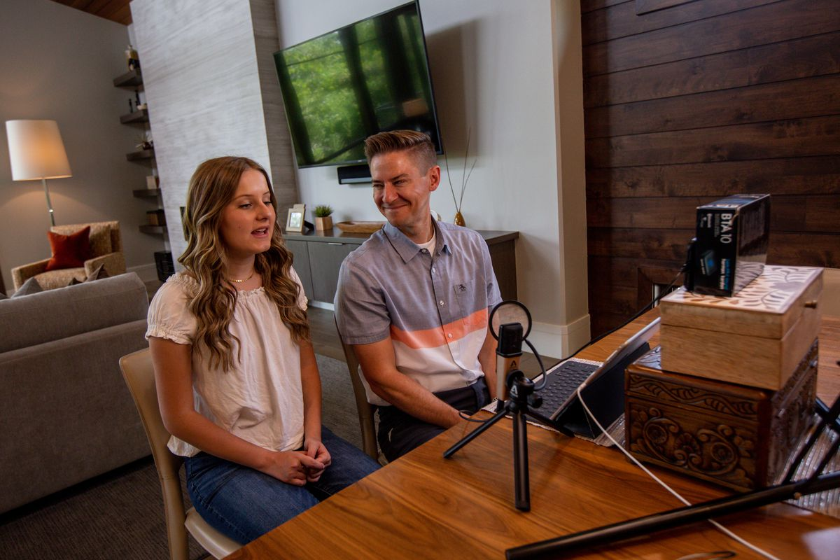 """Savanna Shaw and Mat Shaw record a cover of the song """"Shallow"""" in their family's home on Thursday, May 14, 2020. The father-daughter duets went viral on YouTube as they shared their passion for music amid the COVID-19 pandemic. """"The one thing more contagious than a virus is hope and so we're just doing our small part in the world to spread some hope,"""" Mat Shaw said."""