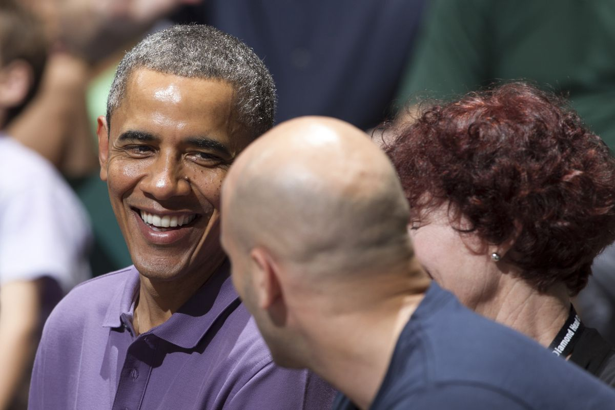 President Obama relaxing at a basketball game.