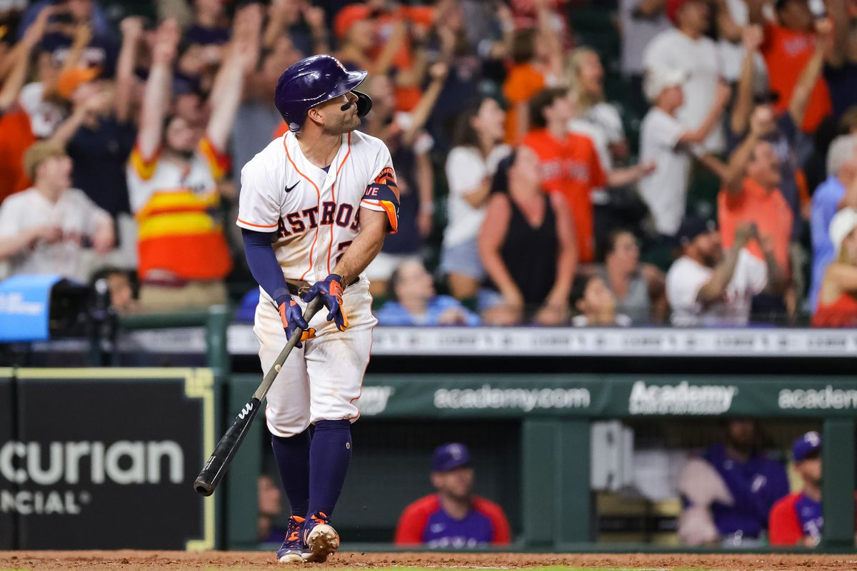 Jose Altuve #27 of the Houston Astros hits a grand slam to defeat the Texas Rangers during the tenth inning 6-3 at Minute Maid Park on June 15, 2021 in Houston, Texas.