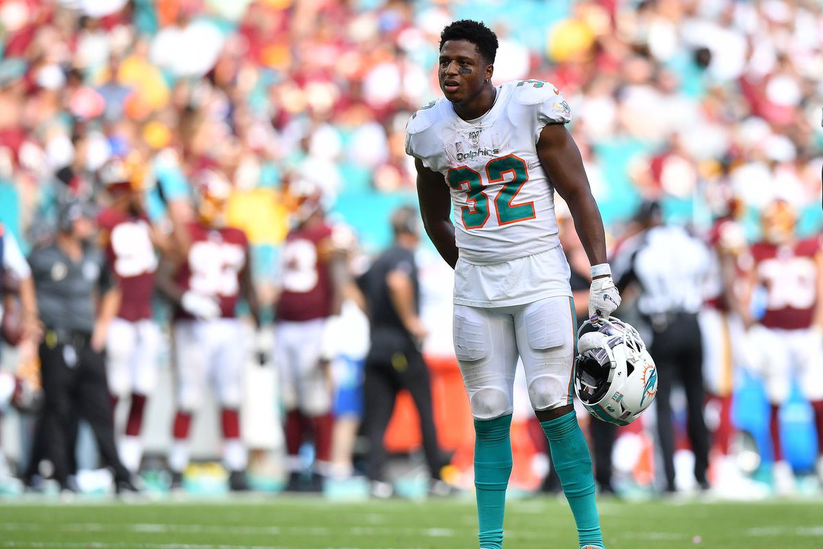 Kenyan Drake of the Miami Dolphins looks on during a break in the game against Washington in the fourth quarter at Hard Rock Stadium on October 13, 2019 in Miami, Florida.