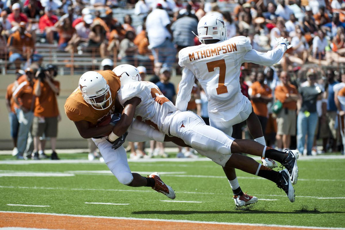Apr 1, 2012; Austin, TX, USA; Texas Longhorns wide receiver DeSean Hales (right) scores a touchdown during the first half of the spring game at Royal-Texas Memorial Stadium. Mandatory Credit: Brendan Maloney-US PRESSWIRE