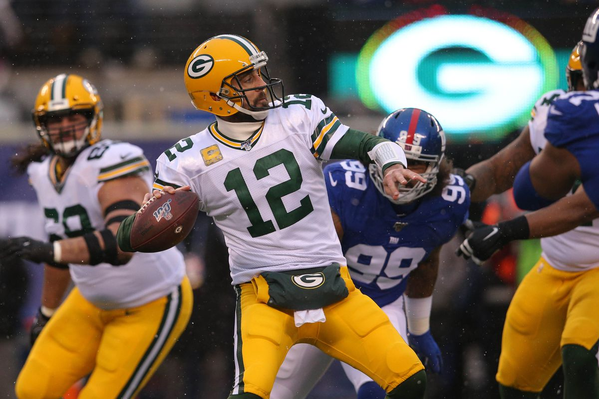 Green Bay Packers quarterback Aaron Rodgers throws a pass against the New York Giants during the first quarter at MetLife Stadium.