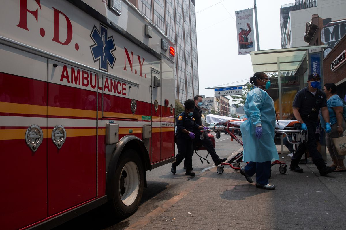 EMTs respond to a person in distress on 125th Street in Harlem, July 20, 2021.