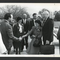 Elder L. Tom Perry and his wife, Barbara, are greeted by leaders of the Gridley California Stake and their wives in March 1987.