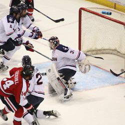 Northeastern's Kevin Roy (15) taps in a goal behind UConn's Rob Nichols (31).